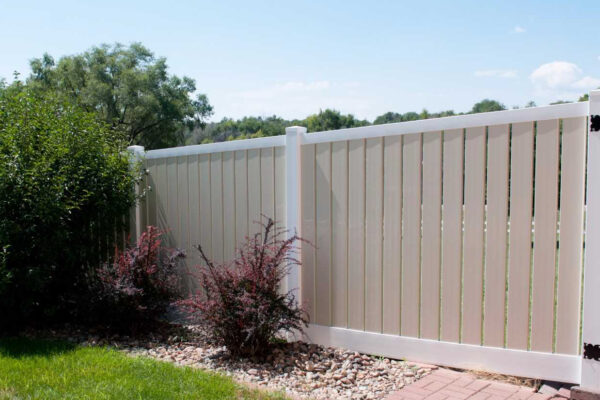 White and almond Lakeview vinyl privacy fence picture